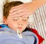 sick child having temperature read
